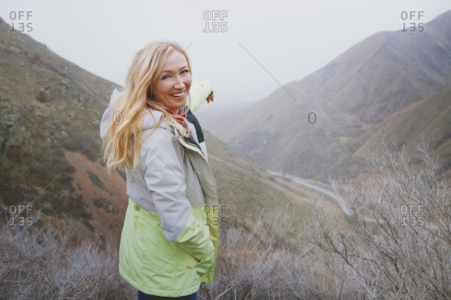 Woman travelling in the foggy Scotland mountains