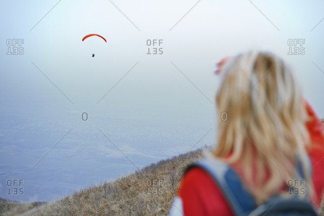 Woman looking at the skydiving paraglider