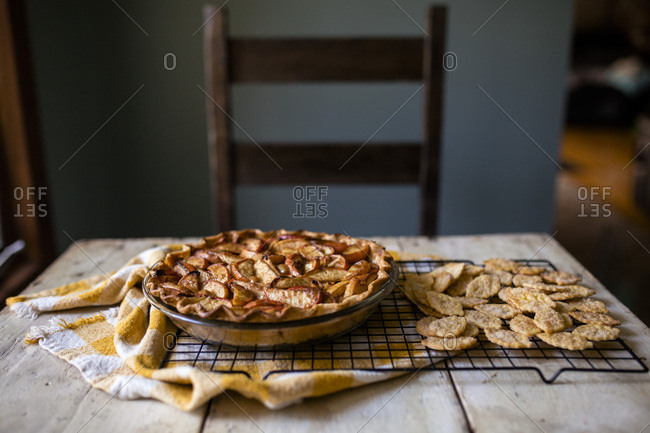 Side view of apple pie on table with empty chair