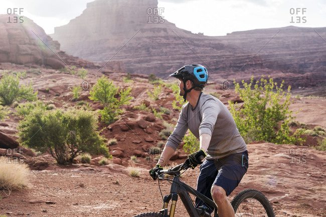Mountain biker cycling against rock formations