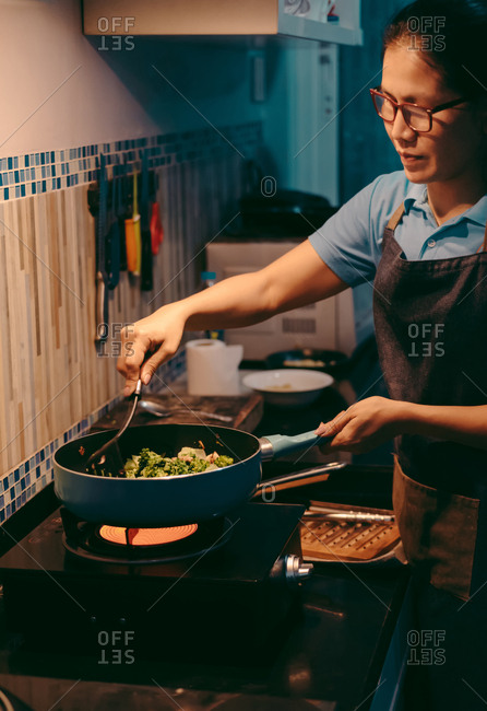 Woman cooking by strove