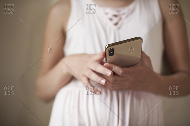 Close up of young girl holding Mobile phone
