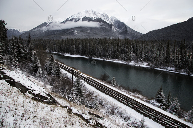Scenic view of river by mountains at Banff National Park during winter