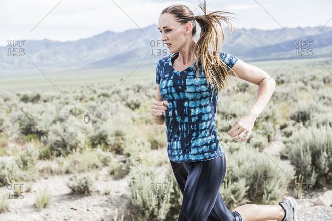 Woman jogging while exercising in desert