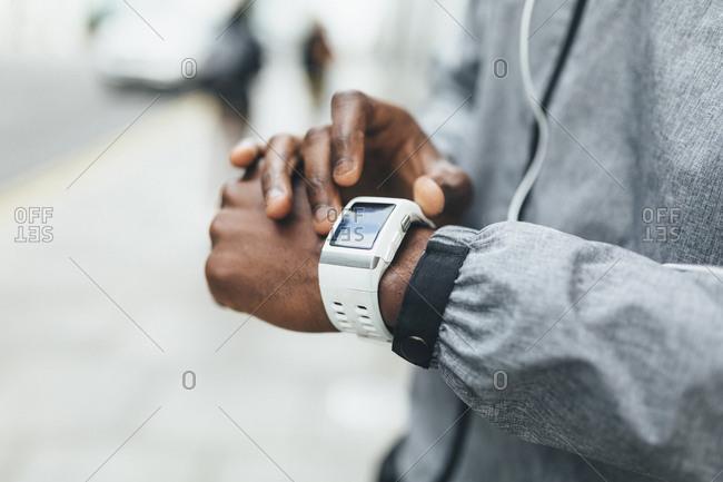 Close-up of athlete using smartwatch