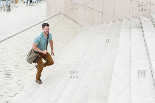 Young man walking upstairs