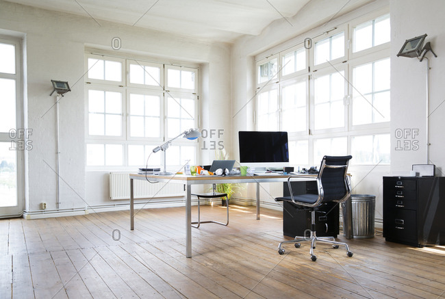 Desk and chair in bright office