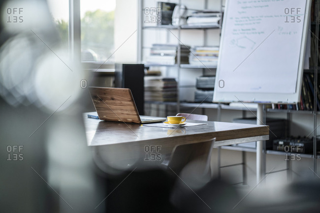 Empty conference room with laptop in office
