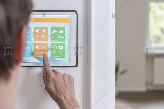 Woman using smart home screen
