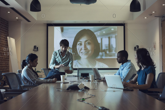 Business people having a video conference in board room