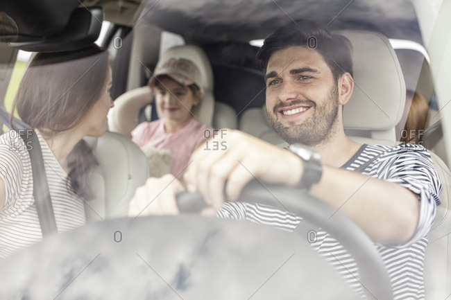 Happy family doing a road trip