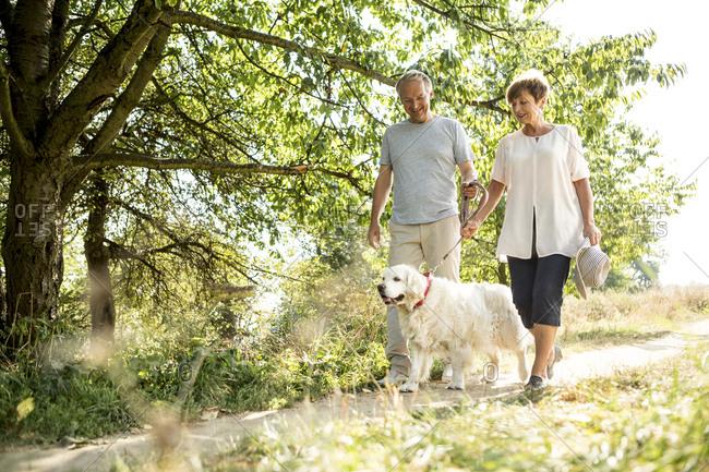 Senior couple going walkies with dog