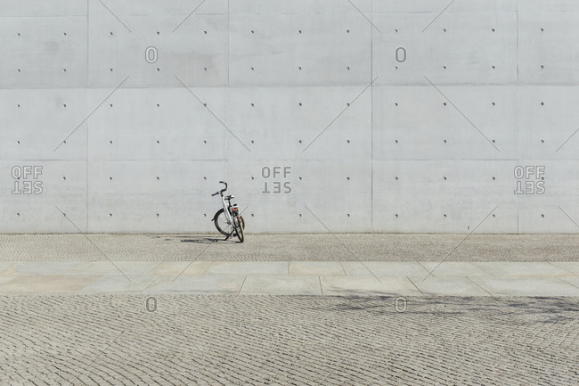 Germany- Berlin- bicycle parking in front of concrete wall at government district
