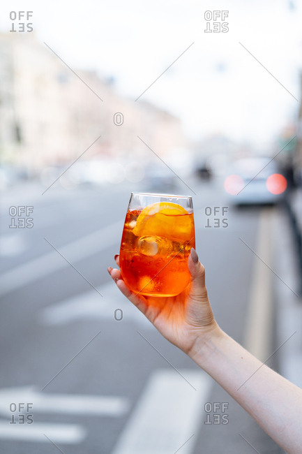 Bright orange cocktail being displayed in the middle of a street.