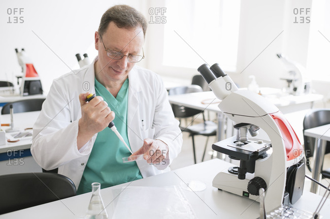 Researcher in white coat working in lab