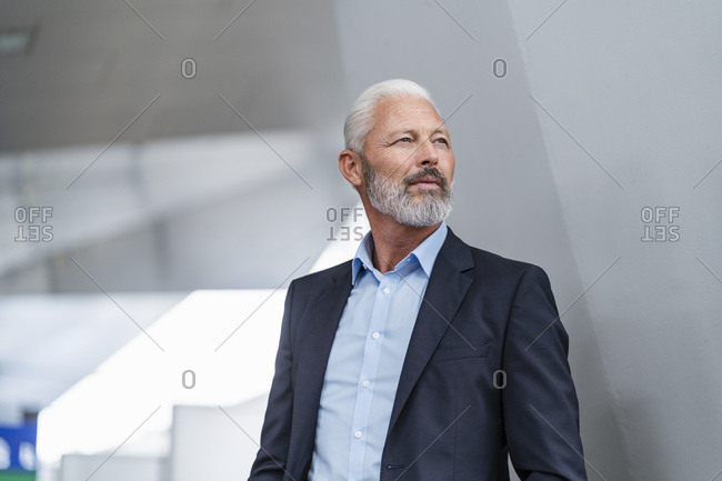 Mature businessman looking away