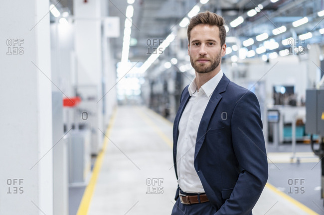 Portrait of a confident businessman in a modern factory