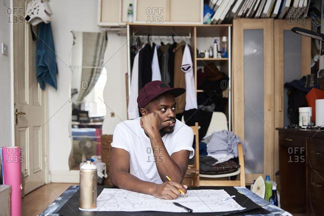 Pensive artist during creative process in studio