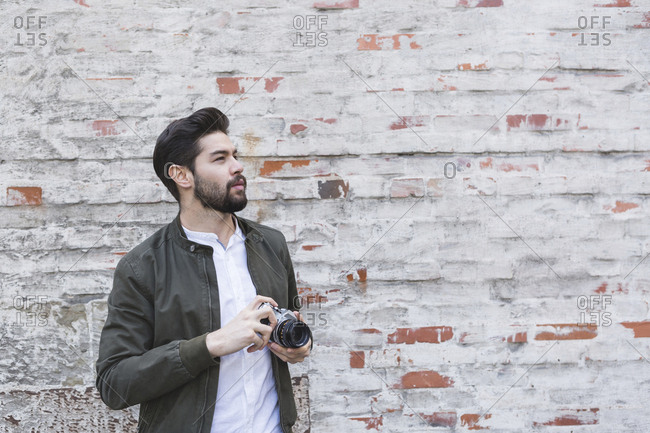 Bearded young man with camera