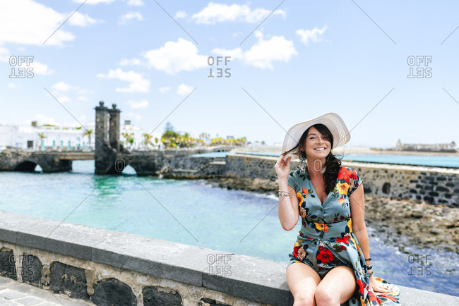 Woman with white sun hat in Arrecife- Spain