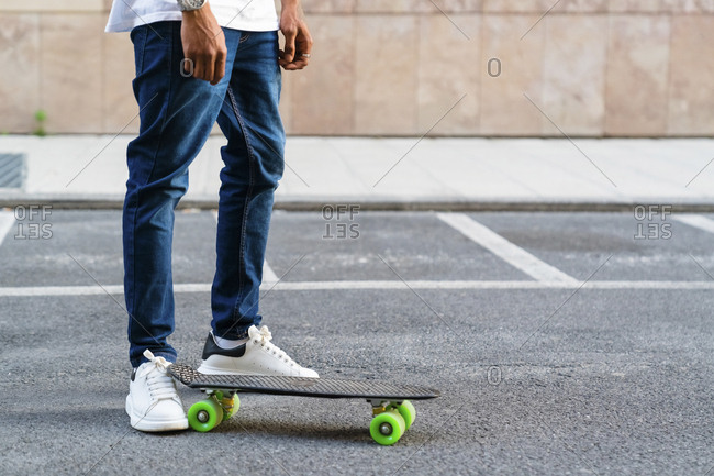 Legs of young man with skateboard