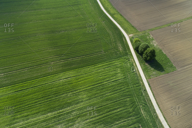 Aerial view of rural road through agricultural fields. Franconia- Bavaria- Germany