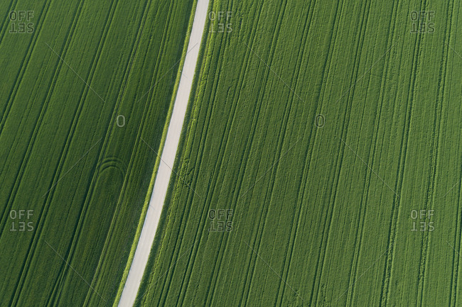 Aerial view of rural road through agricultural fields- Franconia- Bavaria- Germany.
