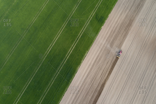 Aerial view of tractor in agricultural field- Franconia- Bavaria- Germany
