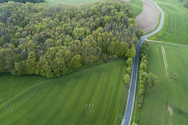 Aerial view of rural road with agricultural fields and forest- Franconia- Bavaria- Germany