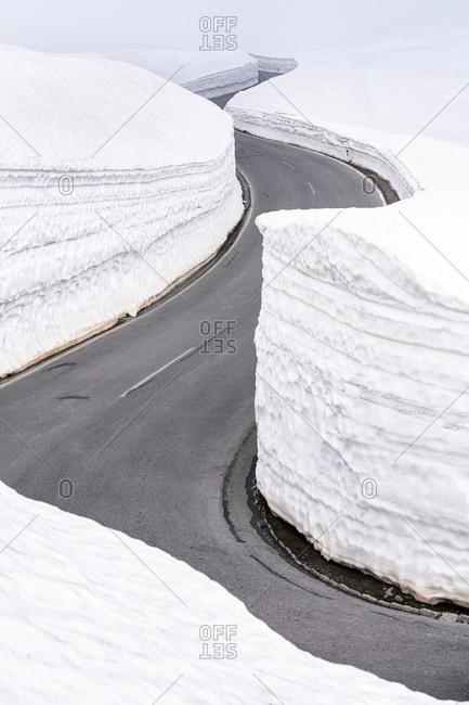 Empty mountain pass road in winter- Timmelsjoch- Tyrol- Austria