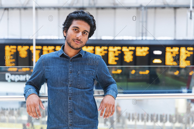 Portrait of man wearing denim shirt at train station- London- UK