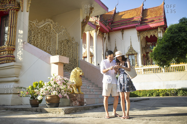 Happy young Chinese couple on vacation in Thailand