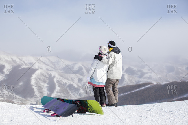 Young couple skiing in ski resort