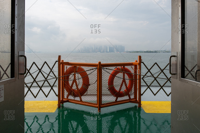 New York NY - USA - Aug 14 2019: Staten Island Ferry on the New York Harbor against of Lower Manhattan skyscrapers