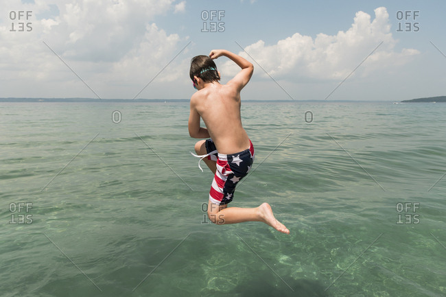 Tween Boy Wearing American Flag Bathing Suit Jumps Into Lake Michigan