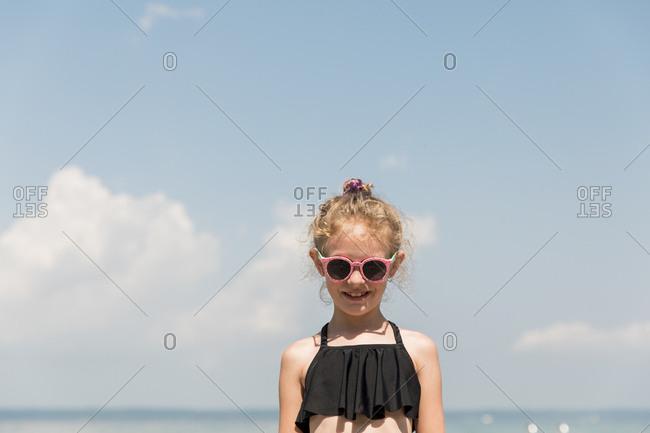 Cute Blonde Girl Wearing Pink Sunglasses at Lake Michigan