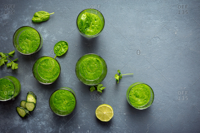 Set of green smoothies on a dark background