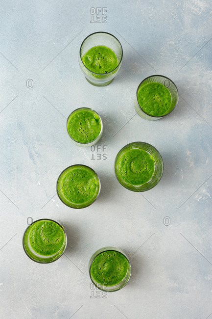 Green smoothie on a light background