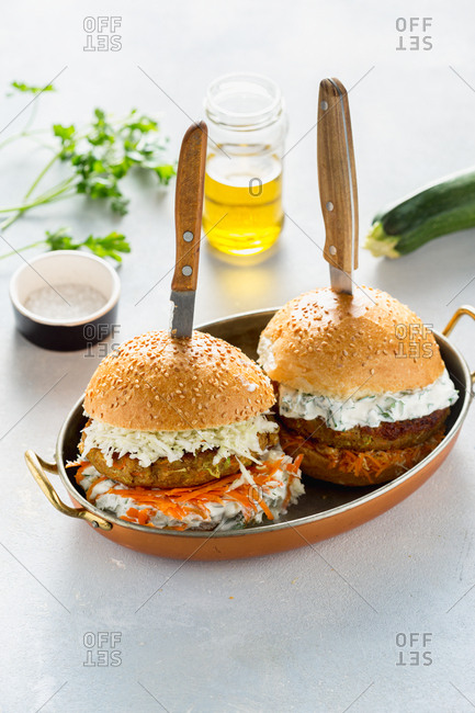 Two vegetarian burgers served in a pan