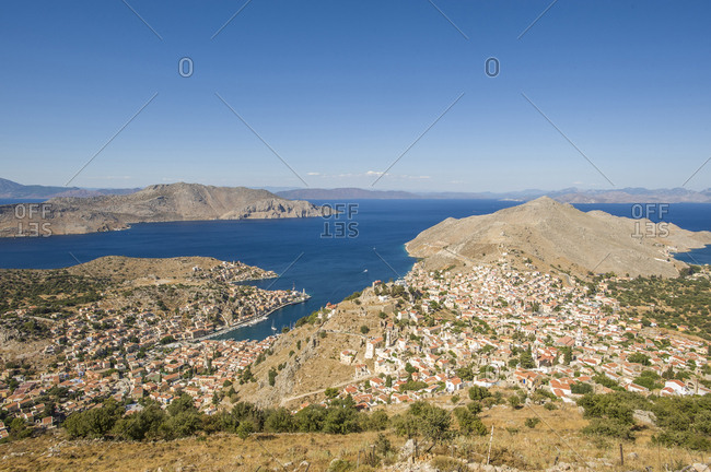 Greece, Dodecanese, Symi . High angle view of the town. Symi is a greek island of the Dodecanese. It is mountainous and includes the harbor town of Symi and its adjacent upper town Ano Symi, as well as several smaller localities, beaches, and areas of significance in history and mythology
