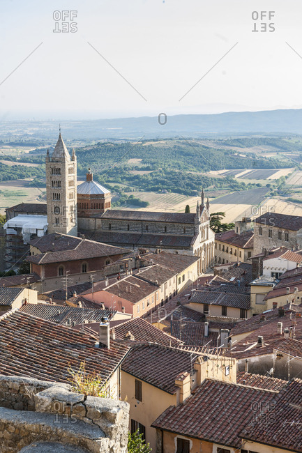 Italy, Tuscany, Massa Marittima . View of the town with Massa Marittima Cathedral, also known Cattedrale di San Cerbone (Duomo) and bell tower. The bell tower is the original 13th-century one in the lower part while the upper area is a 19th-century addition