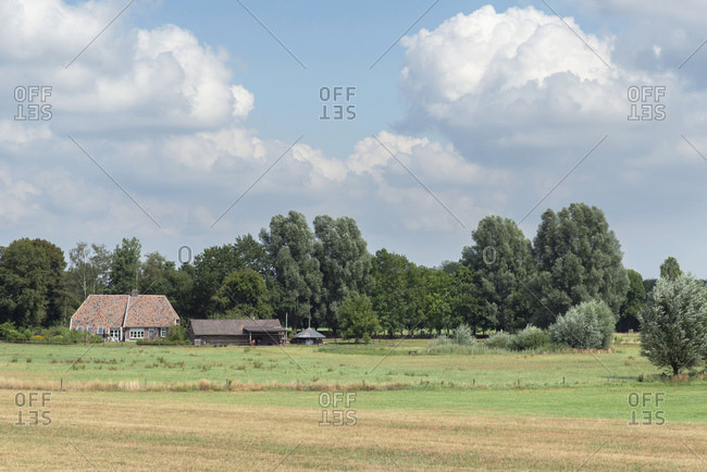 Old farmhouse under cloudy skies