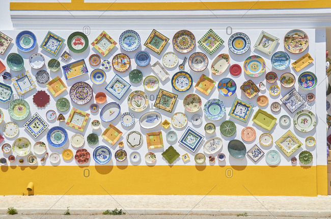 Sagres, Portugal - June 17, 2015: Wall full of decorated porcelain plates