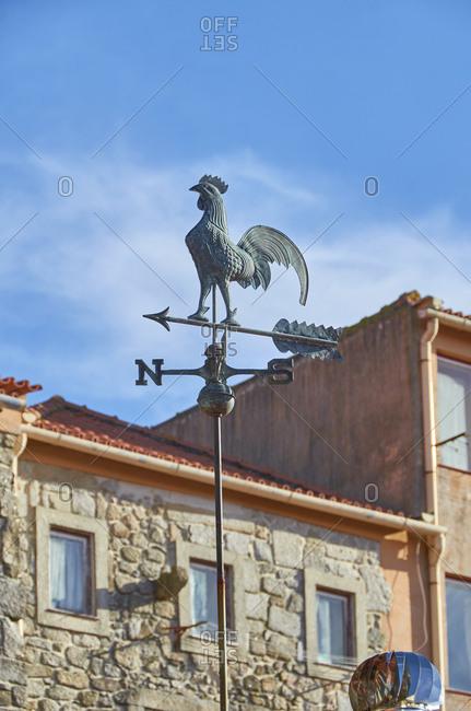 Weather vane atop a building in Porto, Portugal