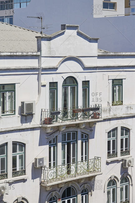 Facade of old building with balconies and windows in Lisbon, Portugal