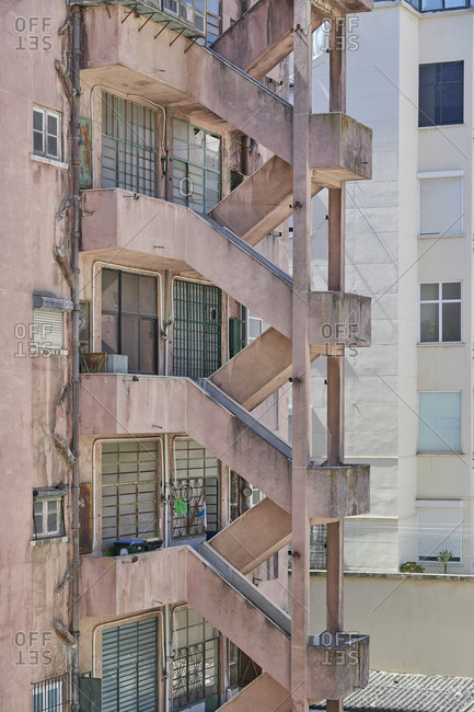 Old apartment building with fire escape in the city of Lisbon, Portugal