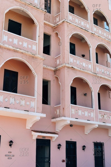 San Juan, Puerto Rico - March 18, 2016: Pink building with balconies