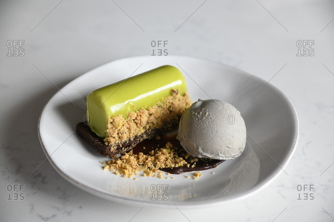 Gourmet green glazed pastry served with ice cream