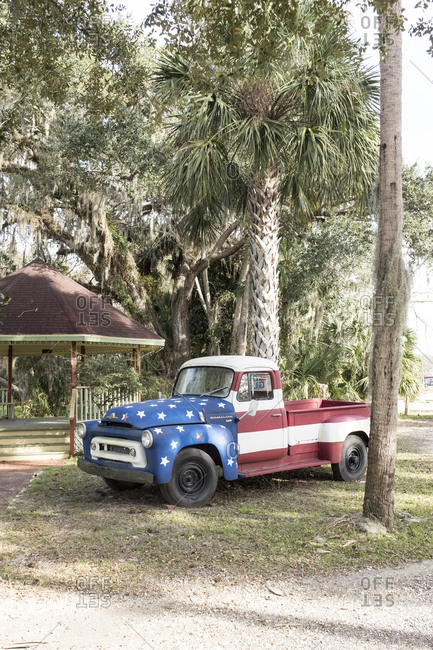 Vintage pick up truck painted with the Stars and Stripes