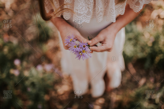 Girl holding purple flowers